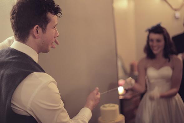 Cutting Cheese Wedding Cake
